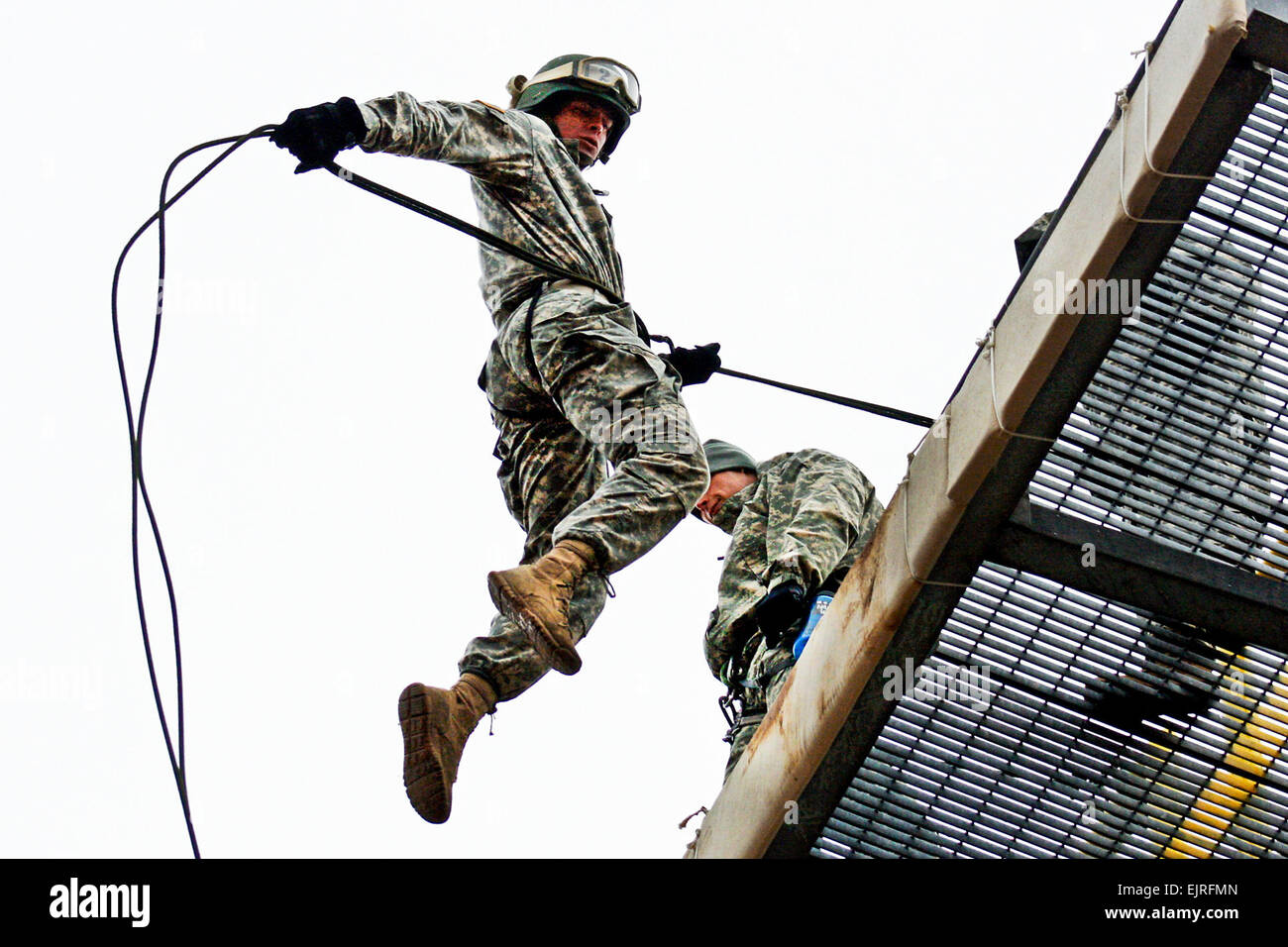 Missouri National Guardsman Cadet Andrew Cully leaps from the top of the rappel tower during part of the Guard's - Stock Image