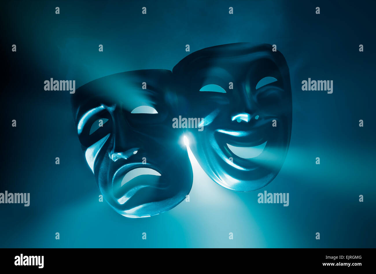 Crying and smiling masks in hazy light. - Stock Image