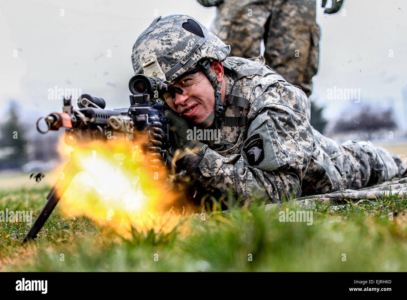 Squeezing the near freezing trigger of his machine gun, a Strike Soldier prepares for realistic combat environments - Stock Image