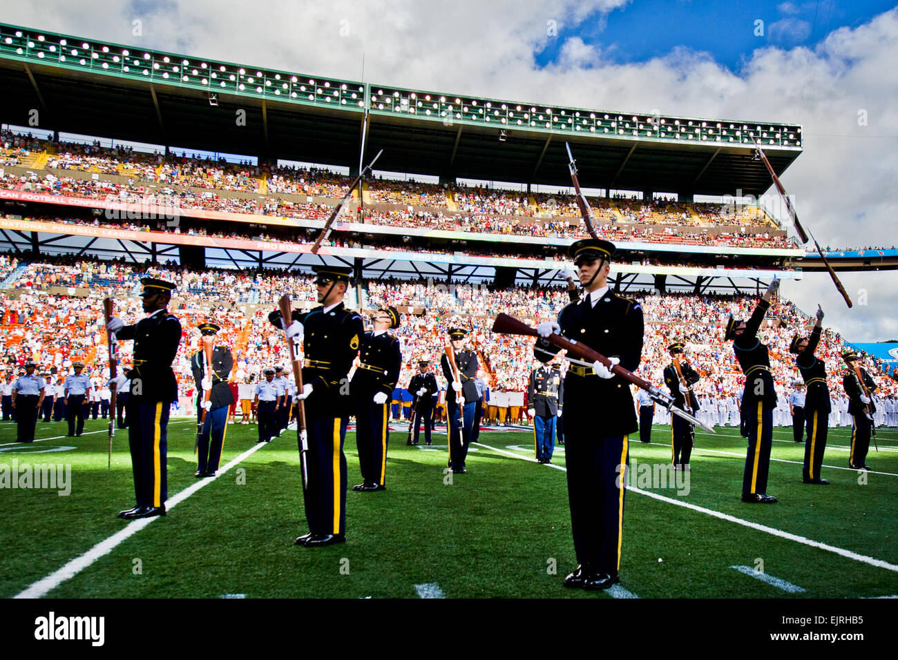 Soldiers assigned to the U.S. Army Drill Team perform at Aloha Stadium during the 2012 National Football League Stock Photo