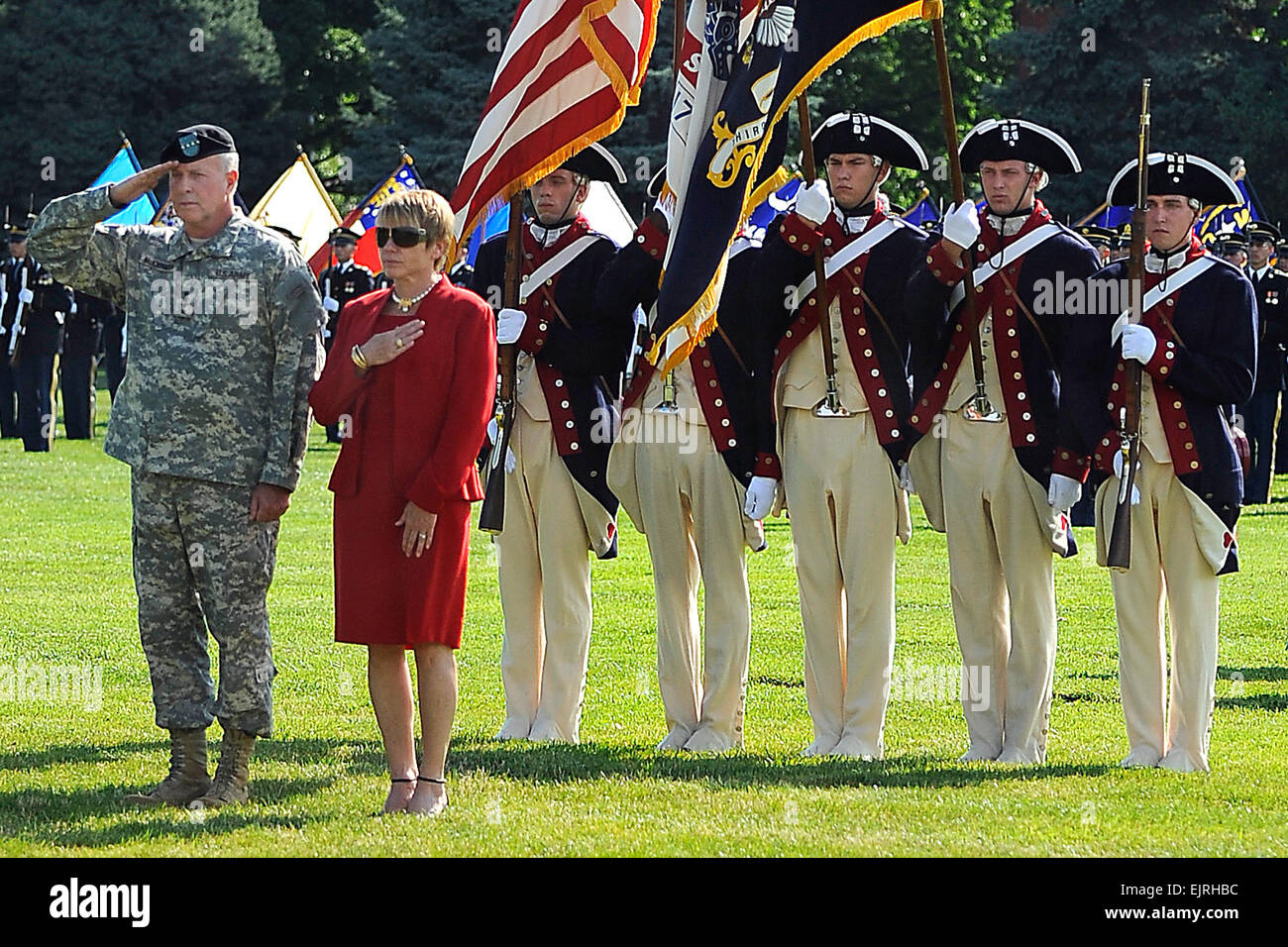 U.S. Army Gen. David D. McKiernan and his wife, Carmen, pay respect during the National Anthem prior to his full - Stock Image