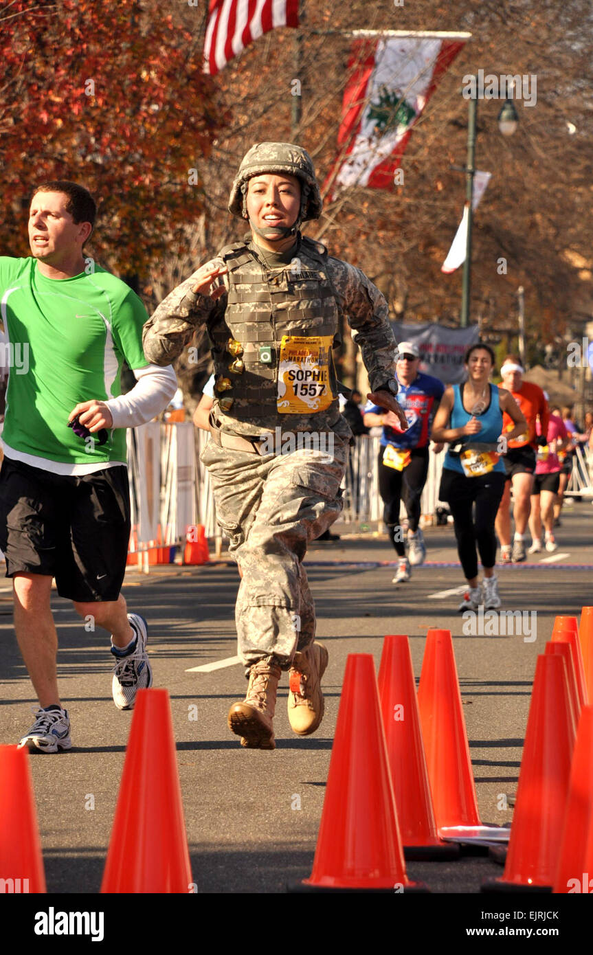 2nd Lt. Sophie Hilaire sprints to the finish of the Philadelphia Marathon, setting a Guinness World Record for women - Stock Image