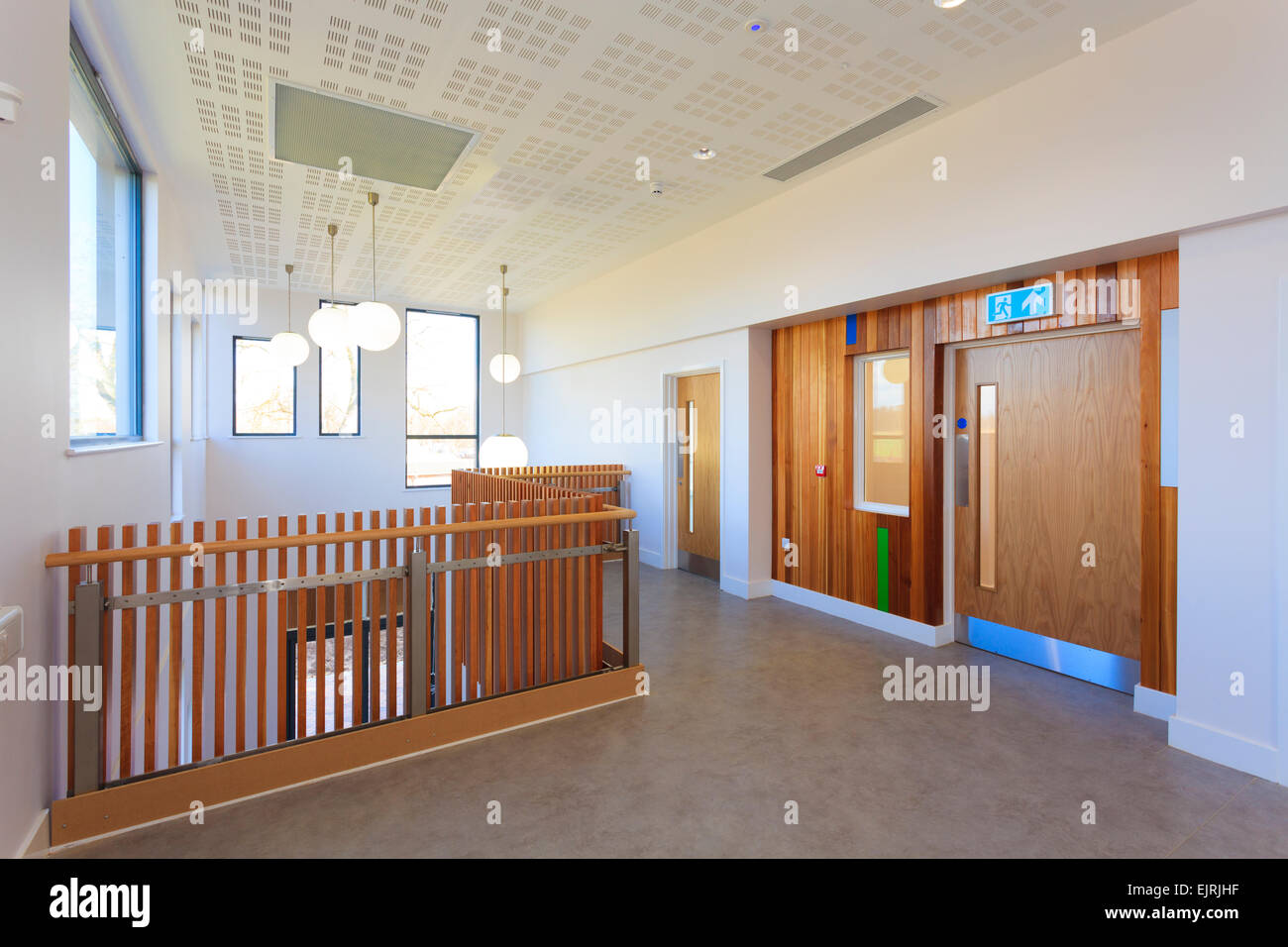 Timber railings and doorway with timberclad surround in modern building without people - Stock Image