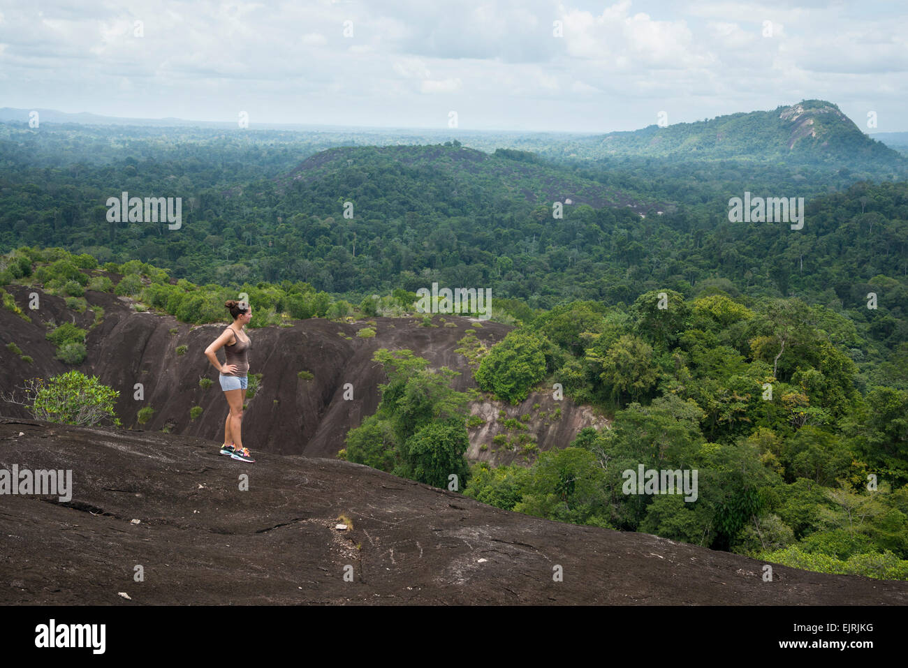 Hiker on Voltzberg Mountain, Central Suriname Nature Reserve, Suriname - Stock Image