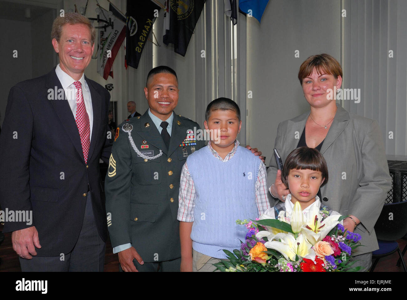 Jonathan Scharfen, acting director of U.S. Citizenship and Immigration Services, poses with Army Sgt. 1st Class Stock Photo