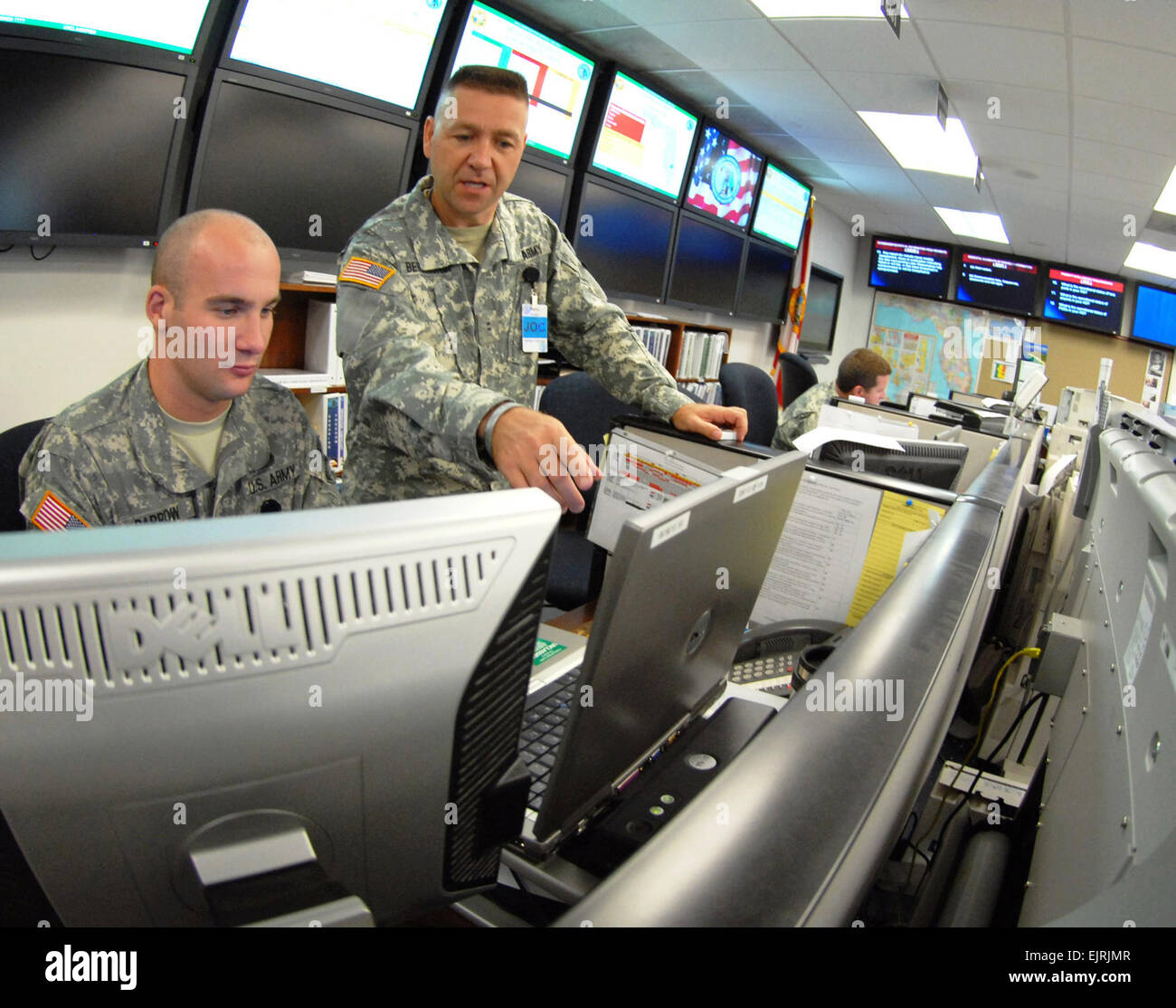 "1st Lt. Daniel Barrow left and Chief Warrant Officer Todd Berlinghof monitor the track of a simulated storm  - ""Hurricane - Stock Image"
