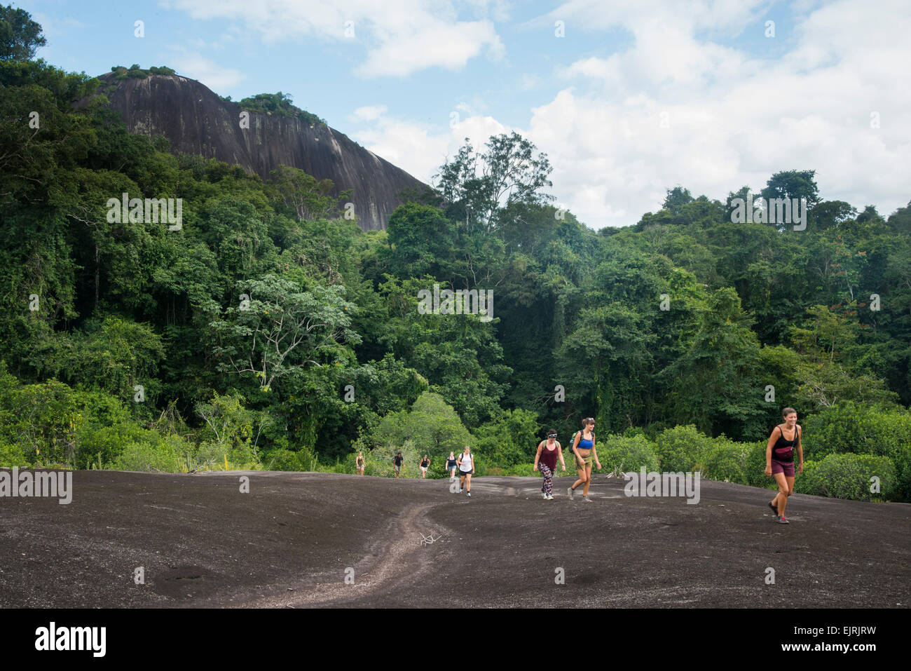 Hikers on Voltzberg Mountain, Central Suriname Nature Reserve, Suriname Stock Photo