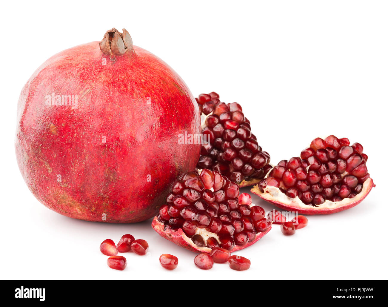 pomegranate with pieces and grains isolated Stock Photo
