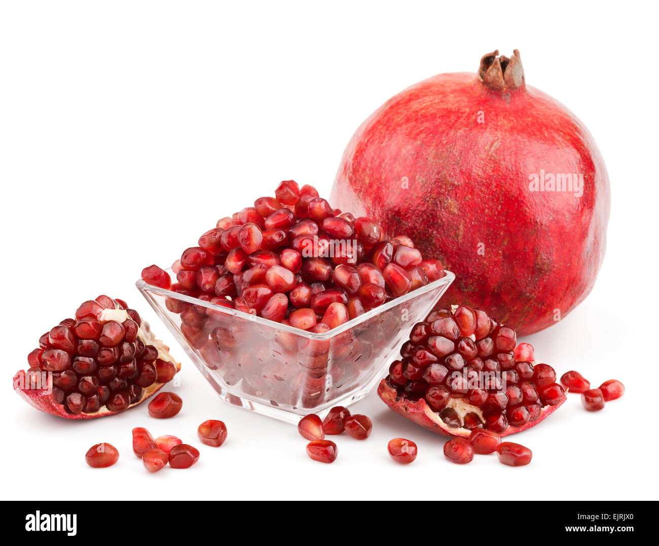 pomegranate with pieces and grains isolated - Stock Image