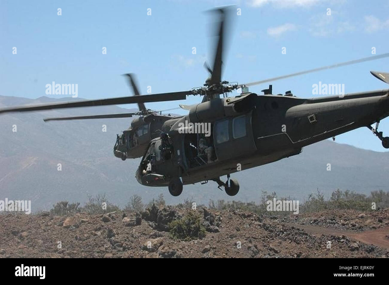 """Two UH-60L Blackhawk helicopters, flown by pilots from the 25th Combat Aviation Brigade's Task Force """"Diamond - Stock Image"""