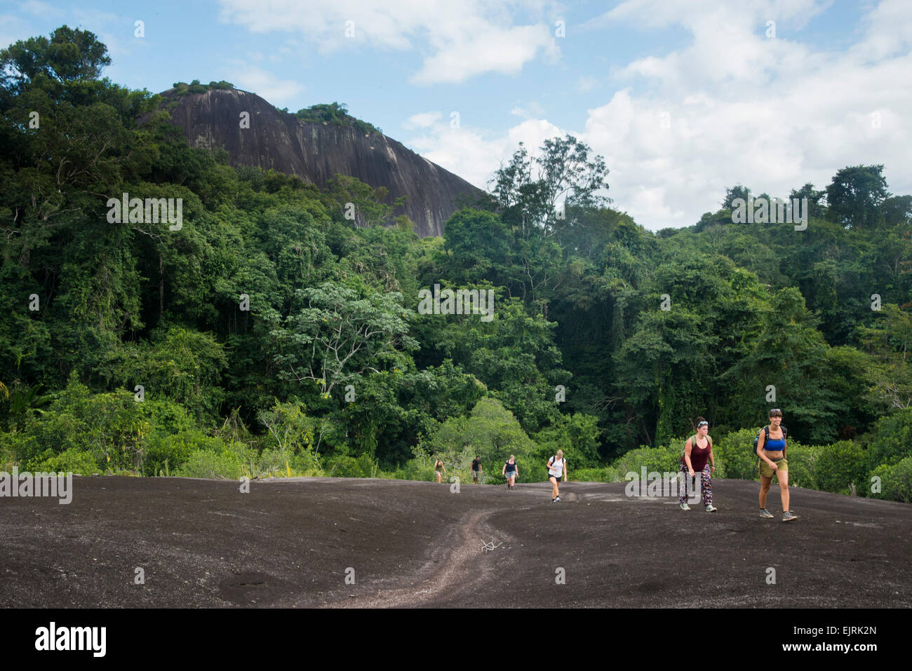 Hikers on Voltzberg Mountain, Central Suriname Nature Reserve, Suriname - Stock Image