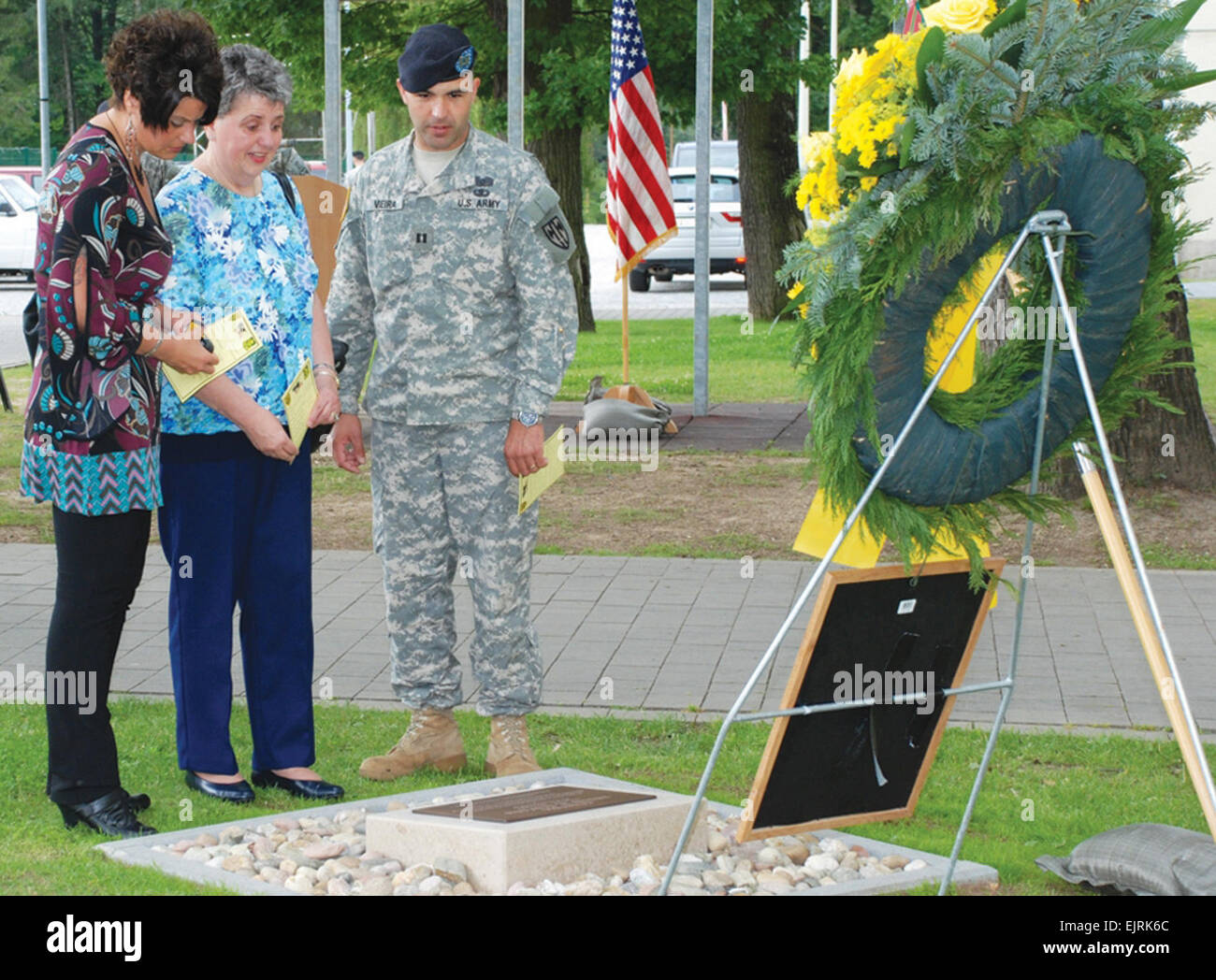Capt. Renato Vieira, 554th Military Police Company commander, shows Kathy Brelsfoard, left, and Carol Ann Clifton, Stock Photo