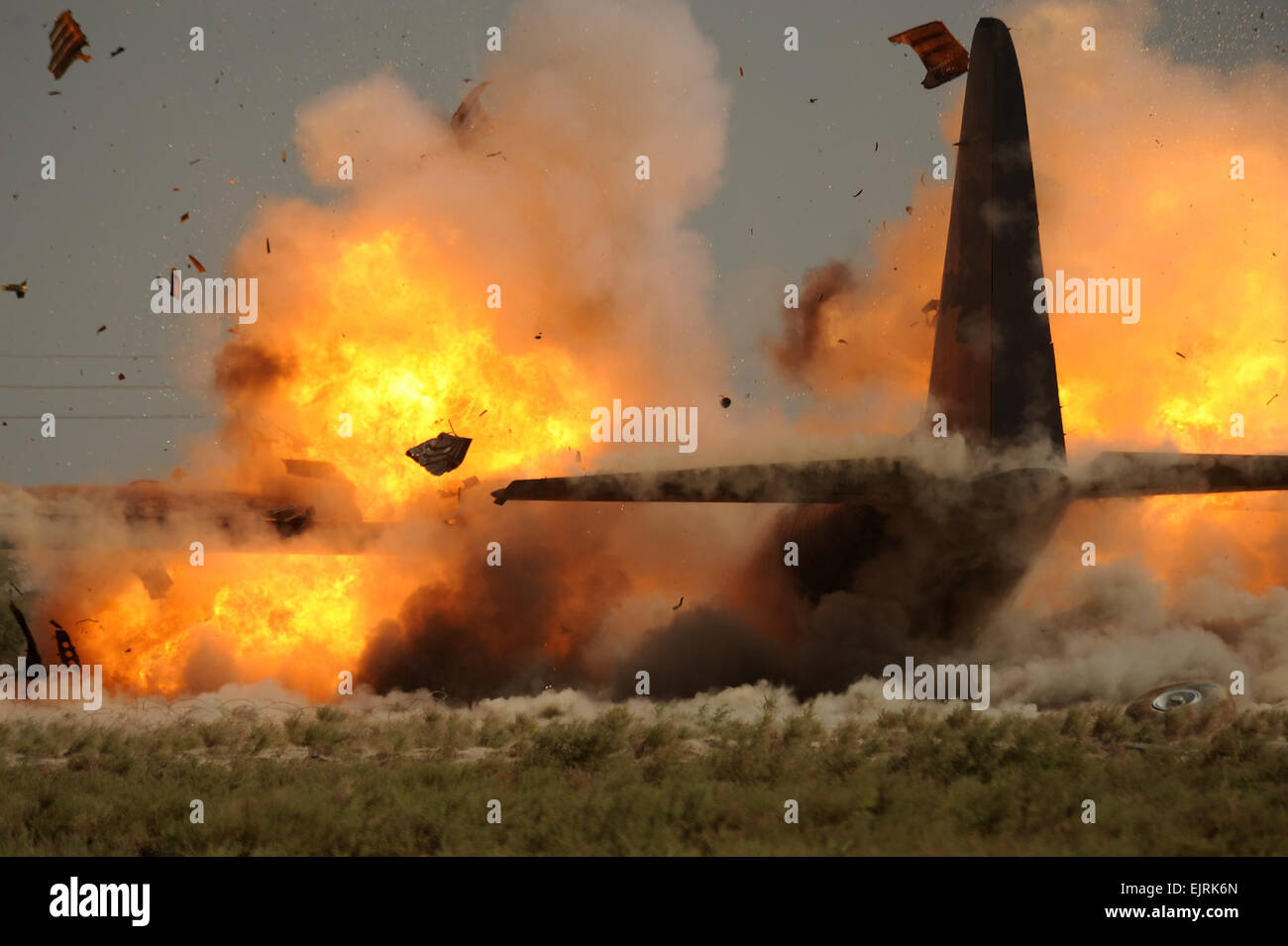 U.S. Air Force explosive ordnance disposalmen from the 447th Air Expeditionary Group detonate explosives attached - Stock Image