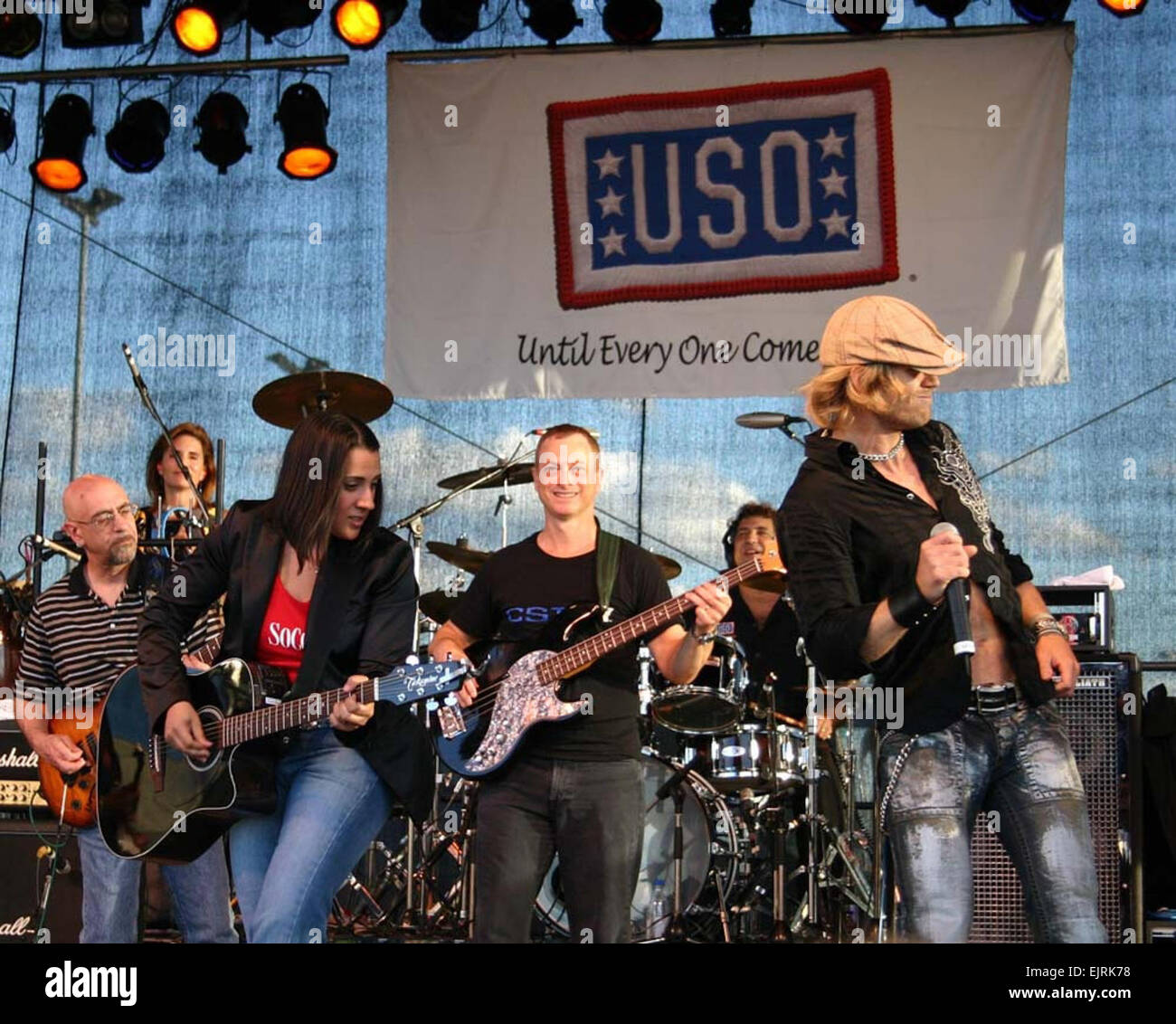 Gina Gonzalez, Gary Sinise, and Jeff Vezain perform as part of the Lt. Dan Band at U.S. Army Garrison Schweinfurt, - Stock Image