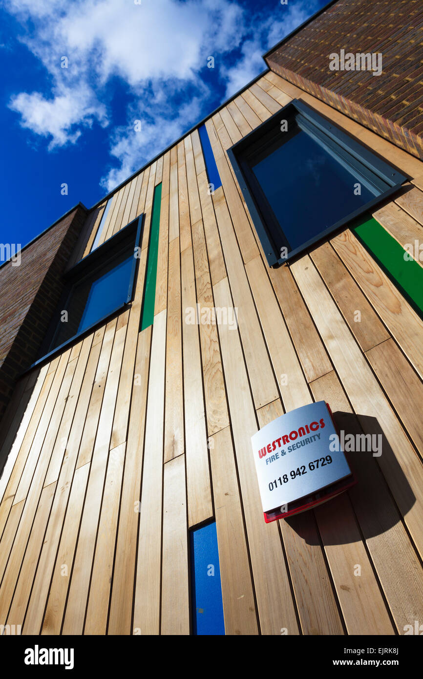 Fire and security alarm on the outside of a modern timberclad building - Stock Image