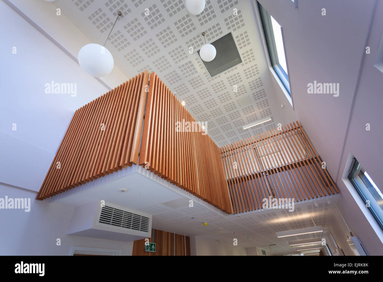 Timber balcony above main communal area of modern college building - Stock Image