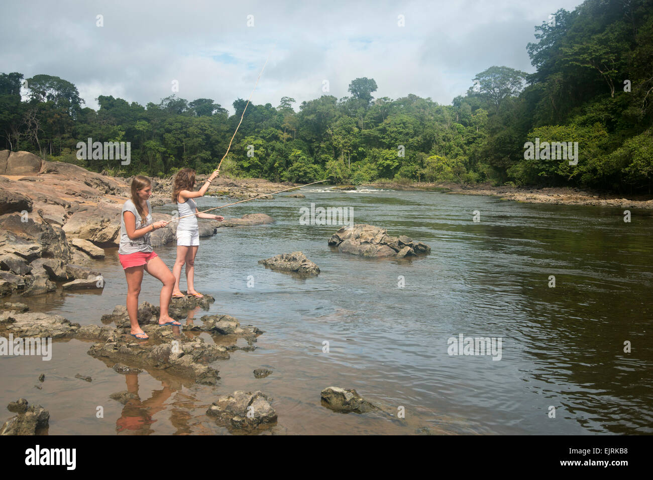 Fishing in the upper Coppename River, Central Suriname Nature Reserve, Suriname - Stock Image