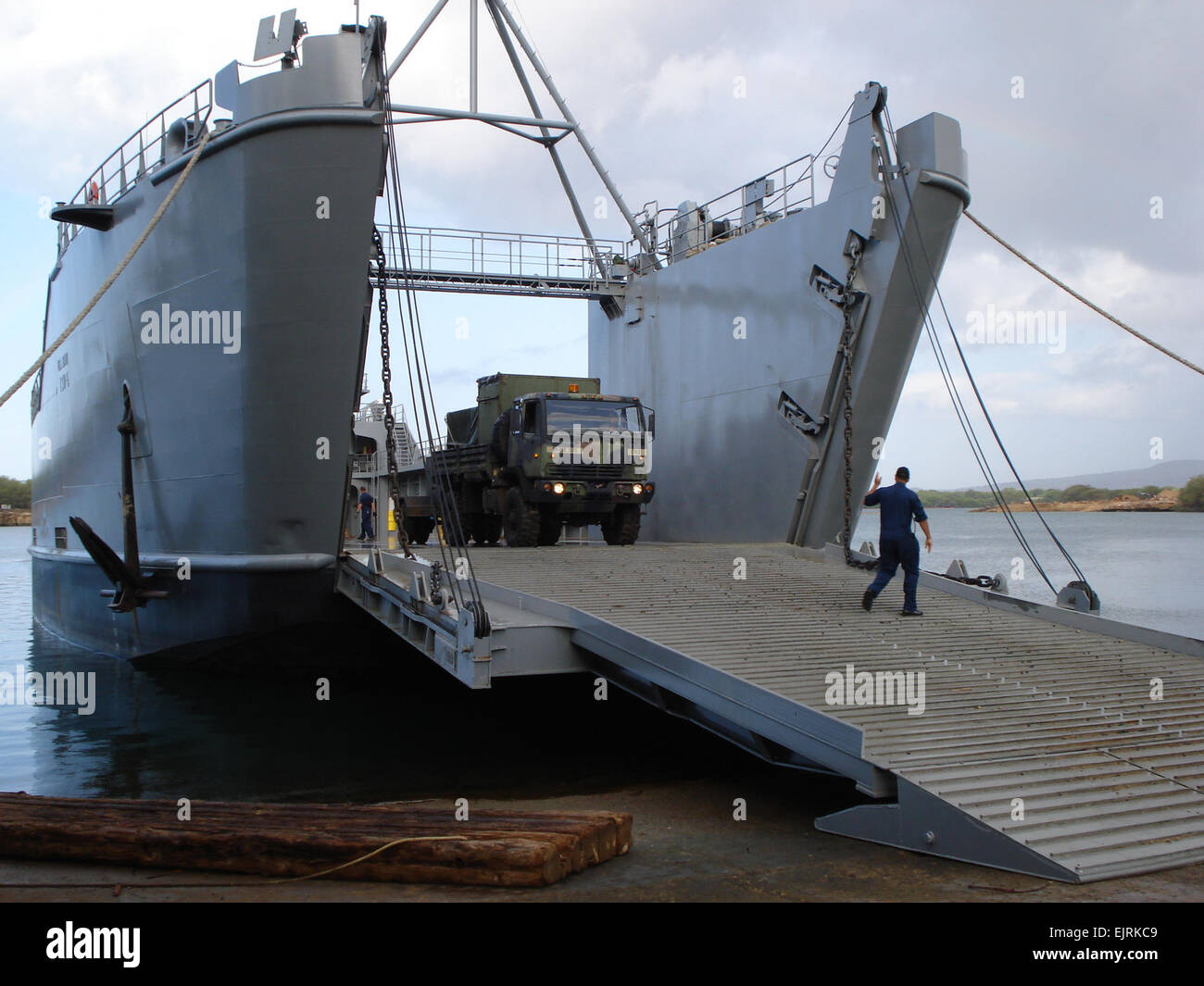 Army Logistics support vessel MG Charles P. Gross is loaded up with 307th Signal Battalion's communications vehicles Stock Photo