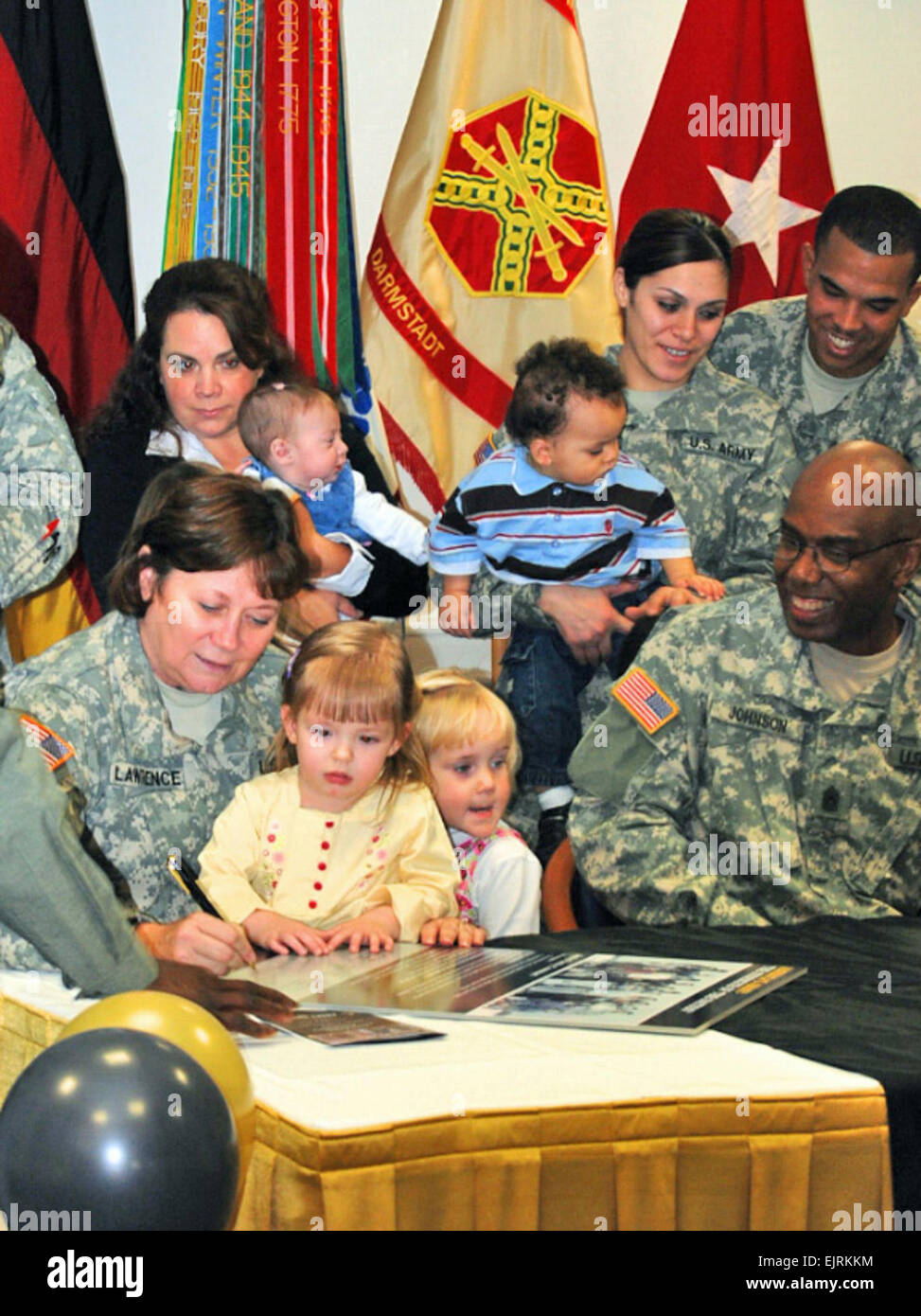 Brigadier General Susan S. Lawrence, surrounded by Army Families, signs the Army Family Covenant at U.S. Army Garrison Stock Photo