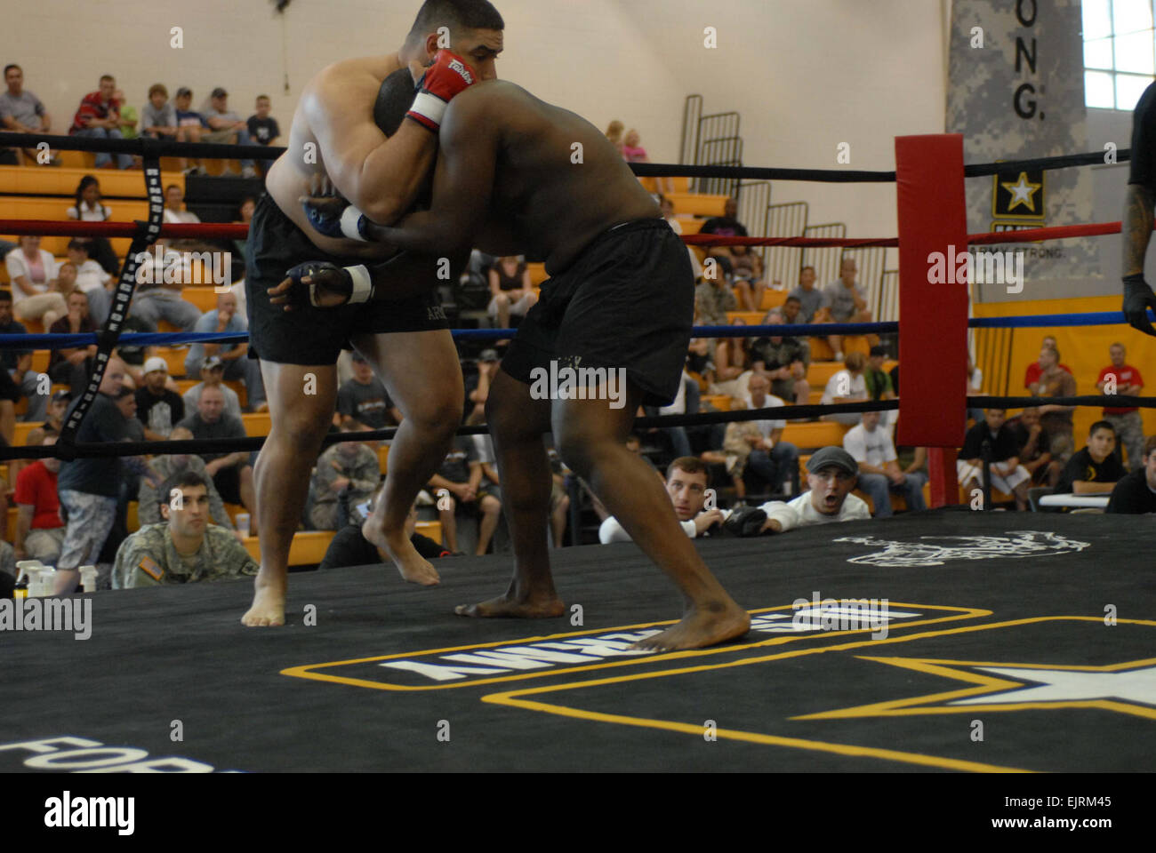 Staff Sgt. Brandon Sayles holds on to Staff Sgt. Benzell Vereen's head.  Sayles earned first place in the Heavyweight - Stock Image