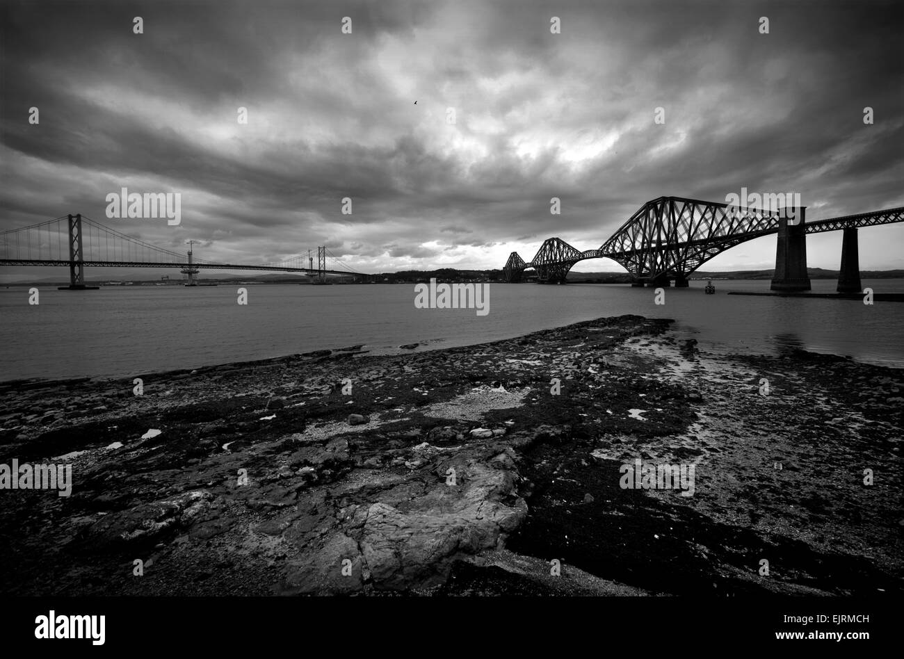 The Firth of Forth road bridge on left and the Rail Bridge on right from South Queensferry Photograph by Brian Harris© - Stock Image