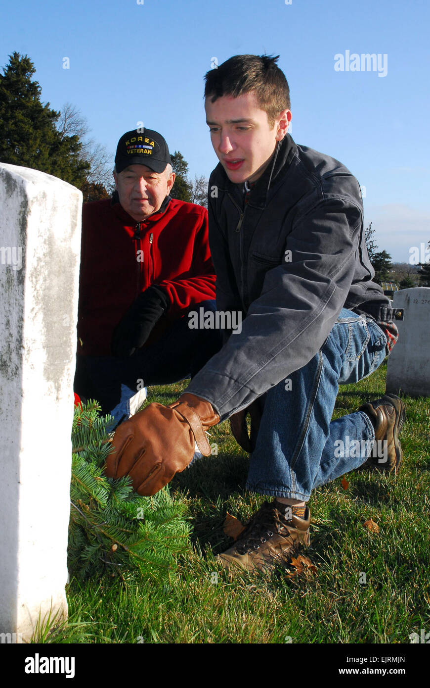 Josh Danis, an 11th grader from Portland, Maine, and his grandfather, Ralph Danis, of Arundel, Maine, lay a wreath - Stock Image