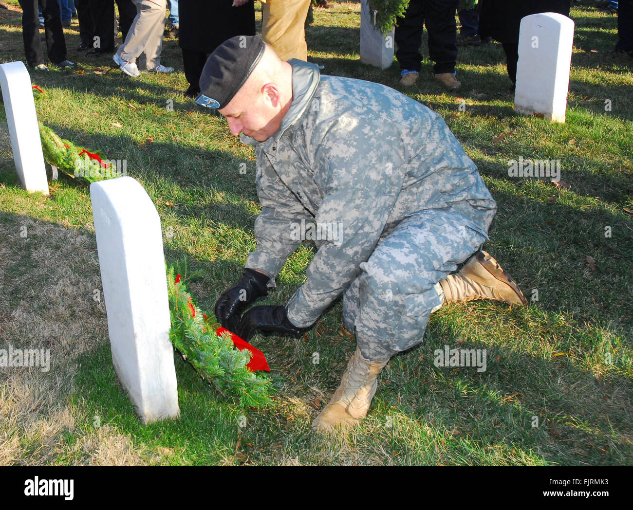 Maj. Gen. Richard J. Rowe Jr., commander, Military District of Washington, lays a wreath at the base of a veteran's - Stock Image
