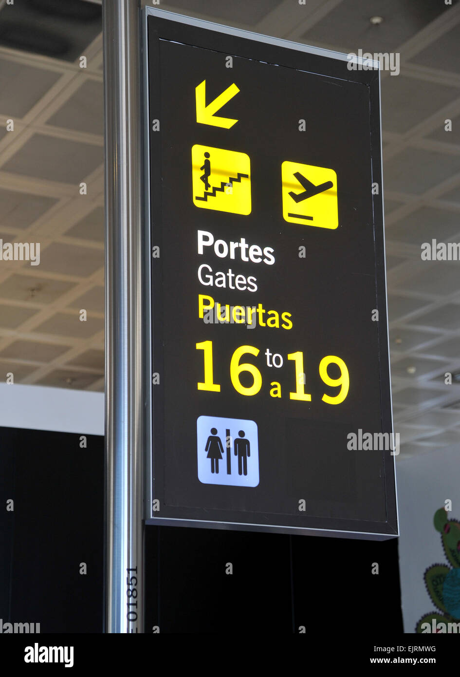 Departure gate sign in Barcelona Airport, Spain - Stock Image