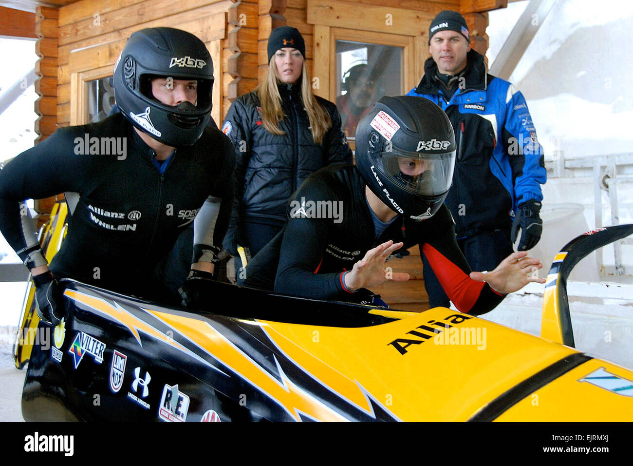 U.S. Army World Class Athlete Program bobsledder Pfc. John Napier right and Cory Butner left get set to push off - Stock Image