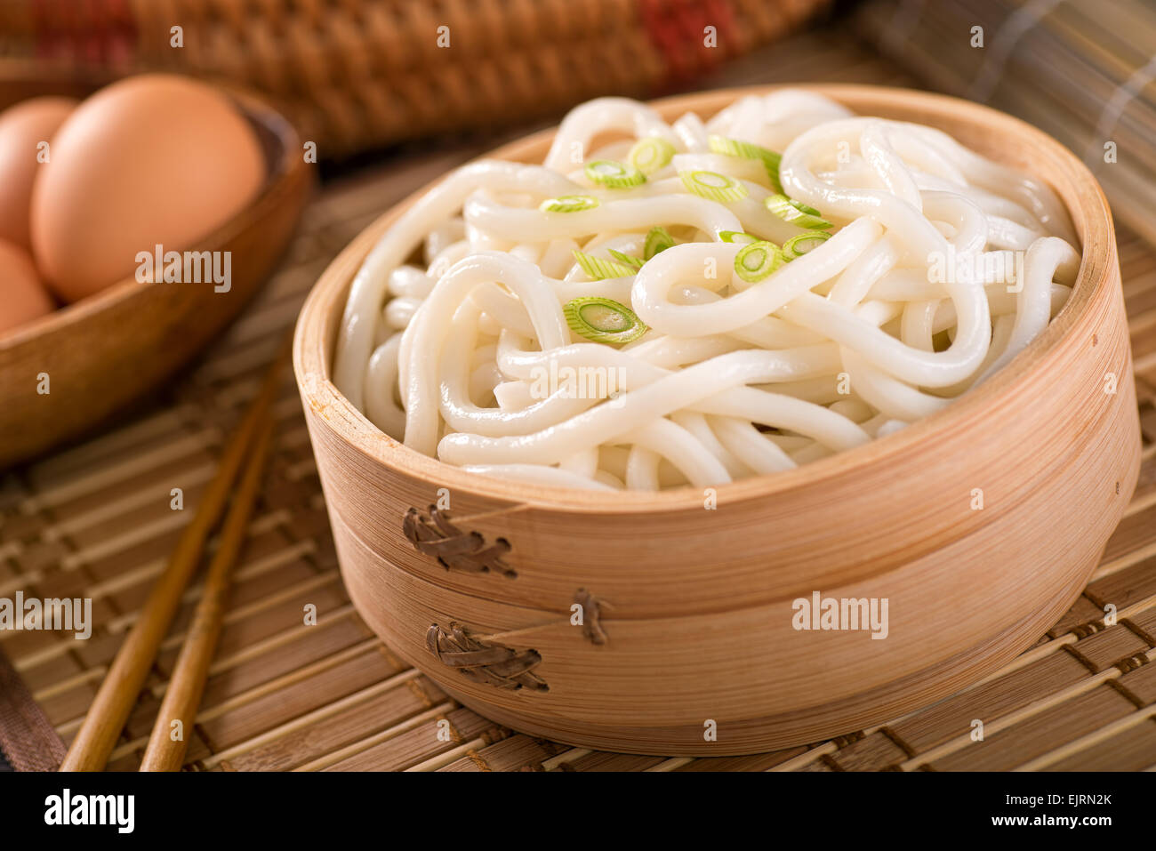 Delicious Japanese udon noodles with green onion. - Stock Image