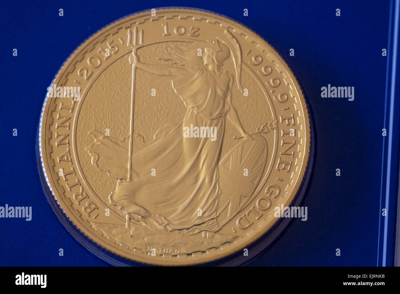 Close up Britannia 2015 one ounce fine gold bullion coin uncirculated valuable investment - Stock Image