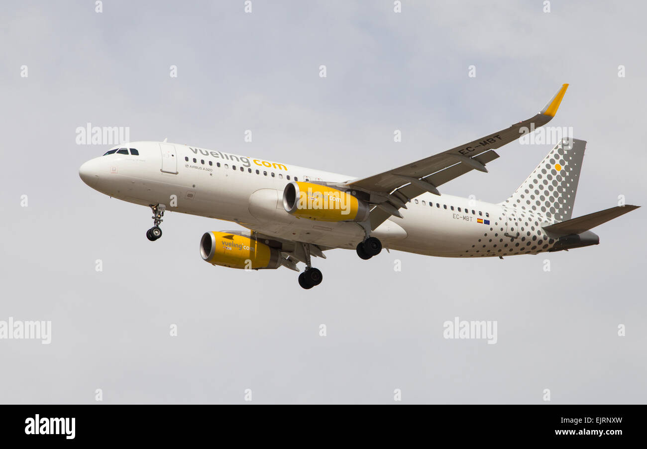 A Vueling Airlines Airbus A320 approaching to the El Prat Airport on March 29, 2015 in Barcelona, S - Stock Image