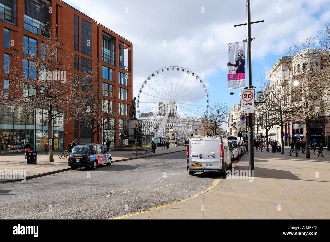 Manchester, UK: Manchester City Centre and the Big Wheel in Picadilly Gardens. - Stock Image