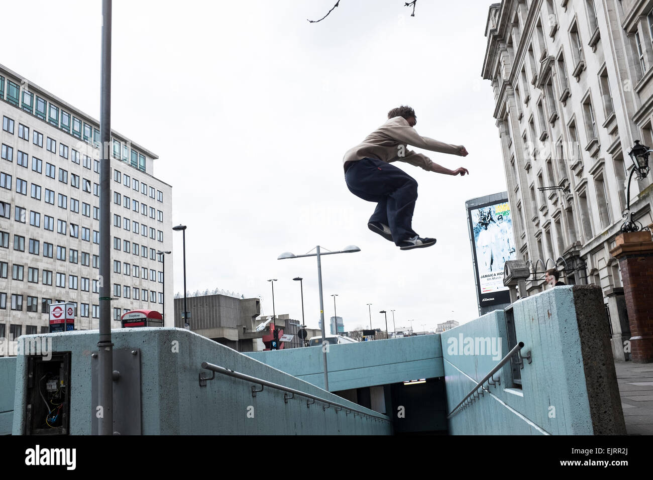 Free Runners practicing Parkour. Parkour is a holistic training discipline enabling practitionaers to get from A Stock Photo