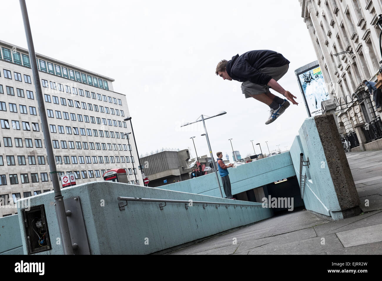 Free Runners practicing Parkour. Parkour is a holistic training discipline enabling practitionaers to get from A - Stock Image