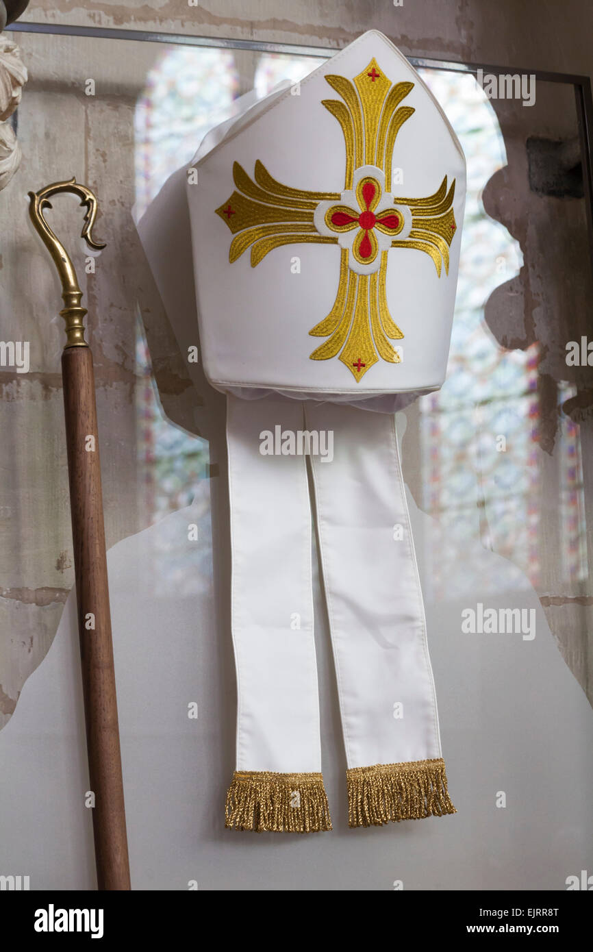 Bishops mitre (hat) and crook (stick) on display in Chapter House, Salisbury Cathedral, Salisbury, Wilshire, UK - Stock Image