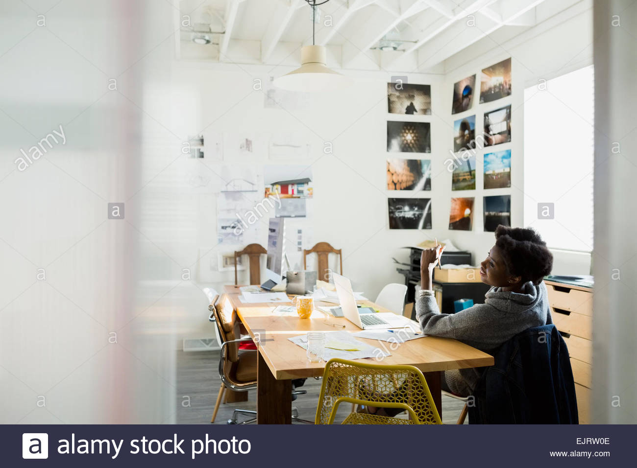 Designer working in office - Stock Image
