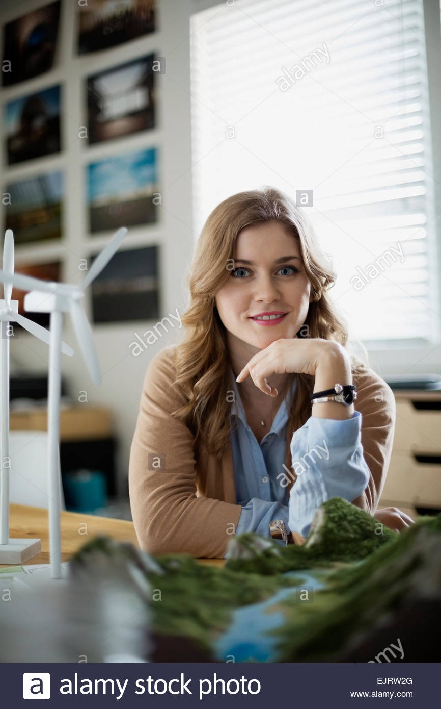 Portrait of confident engineer with wind turbine models Stock Photo