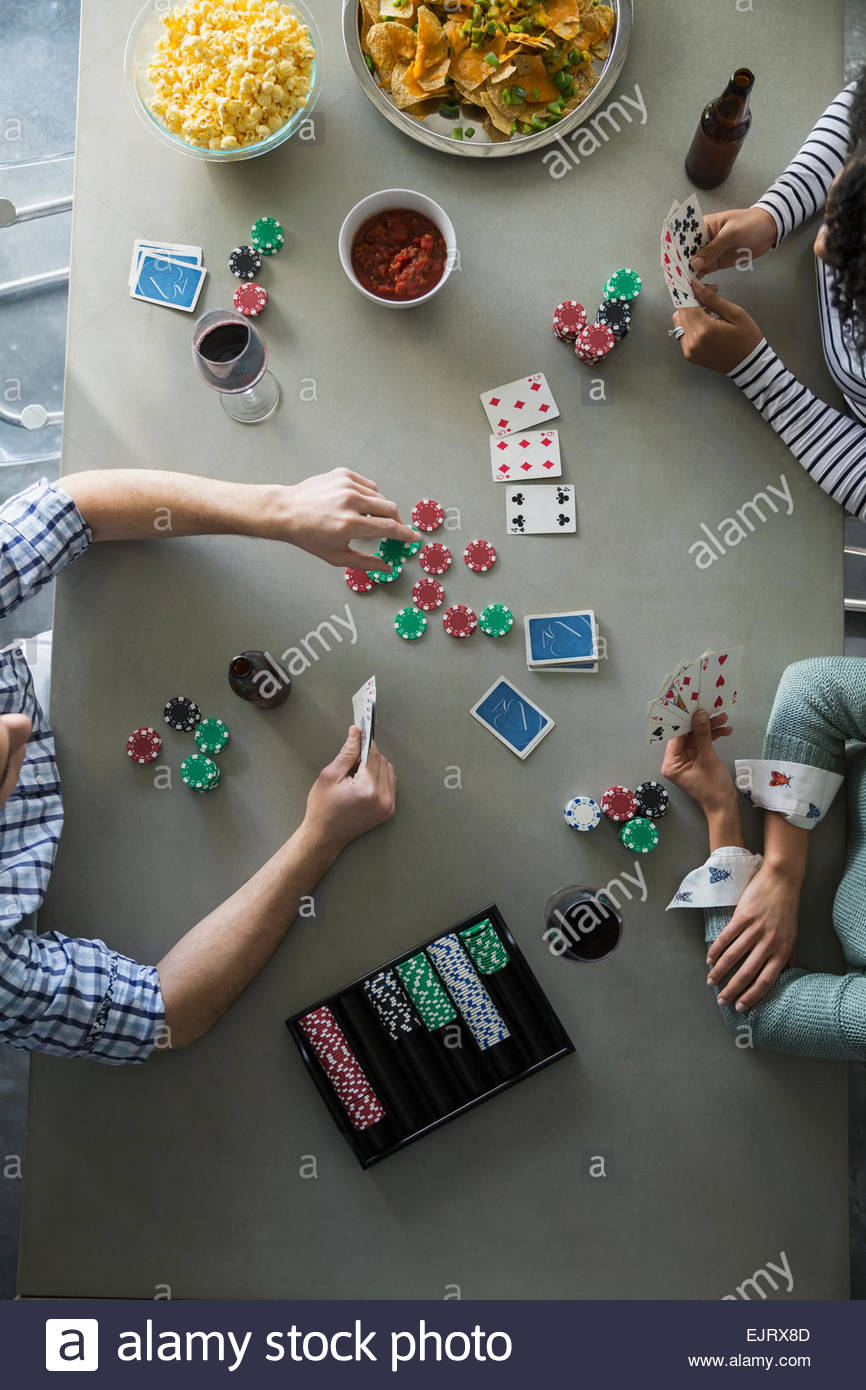 Overhead view of friends playing poker - Stock Image