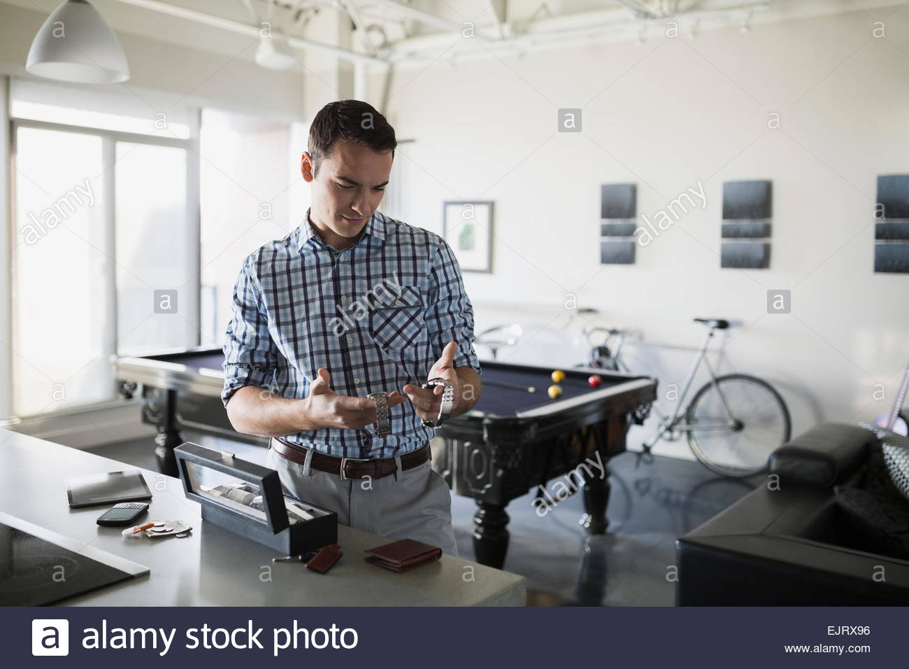 Man comparing wristwatches - Stock Image