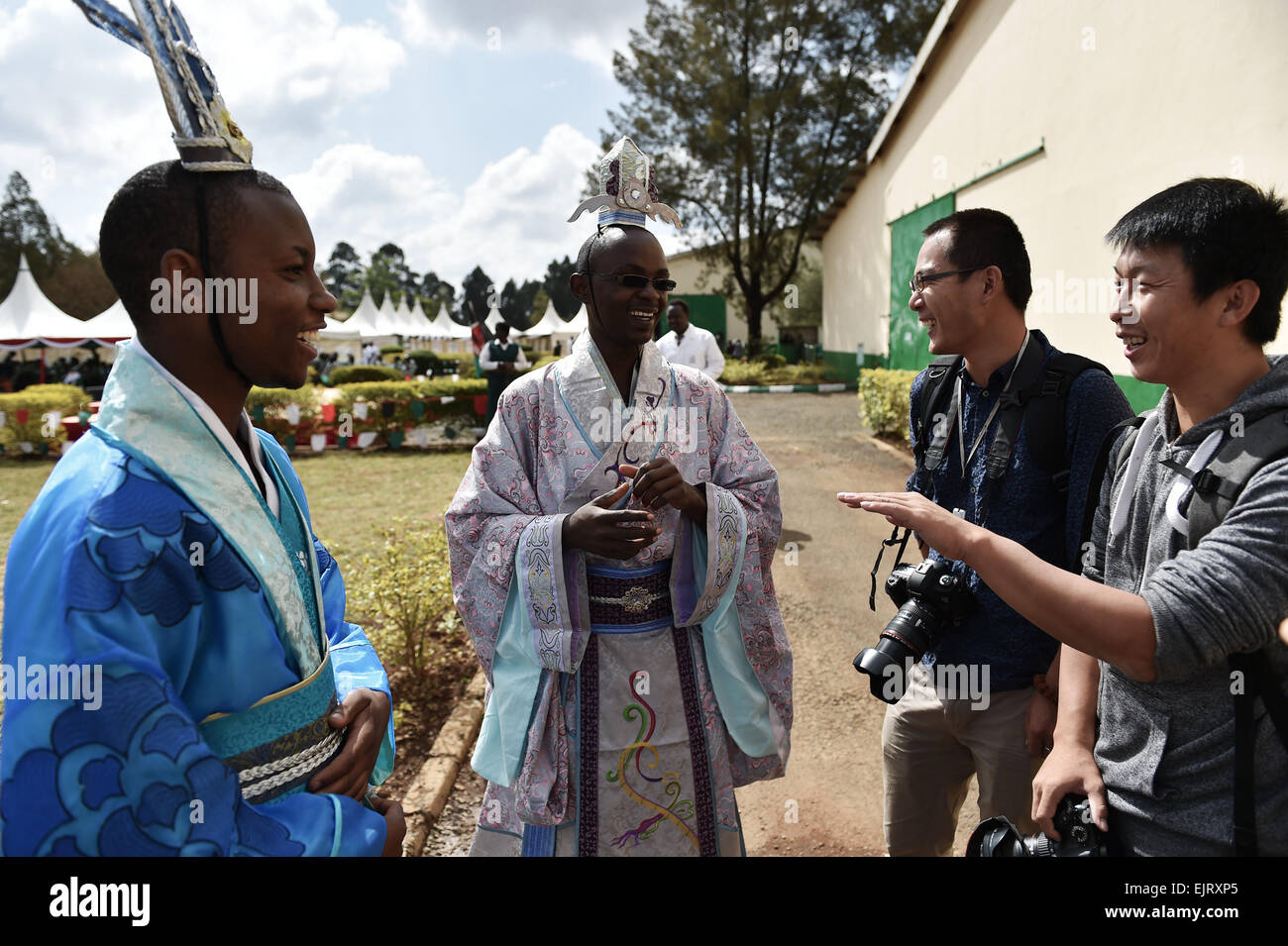 Eldoret, Kenya. 30th Mar, 2015. Kevin (1st L) and Dennis (2nd L), students of Moi University, chat with Chinese Stock Photo