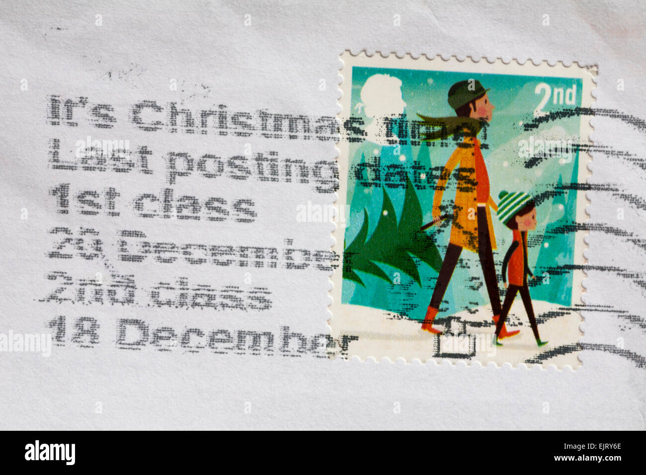 2nd class Christmas stamp on envelope with details of last posting dates for Christmas - Stock Image