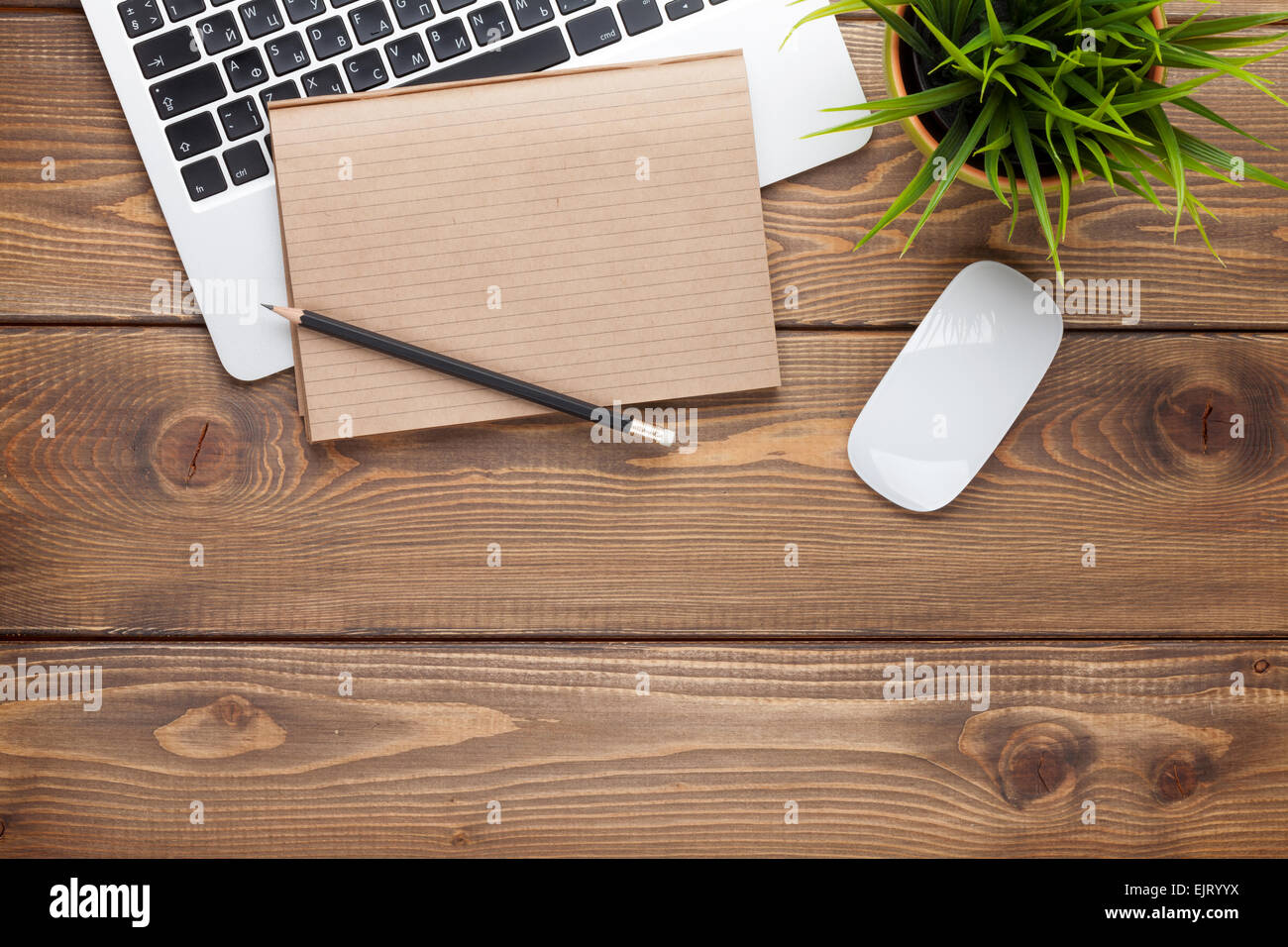 office desk table with computer supplies and flower top view with stock photo 80432126 alamy. Black Bedroom Furniture Sets. Home Design Ideas