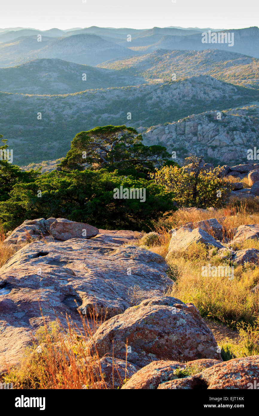 The summit of Mt. Scott in Oklahoma's Wichita Mountains National Wildlife Refuge in the light of the setting - Stock Image