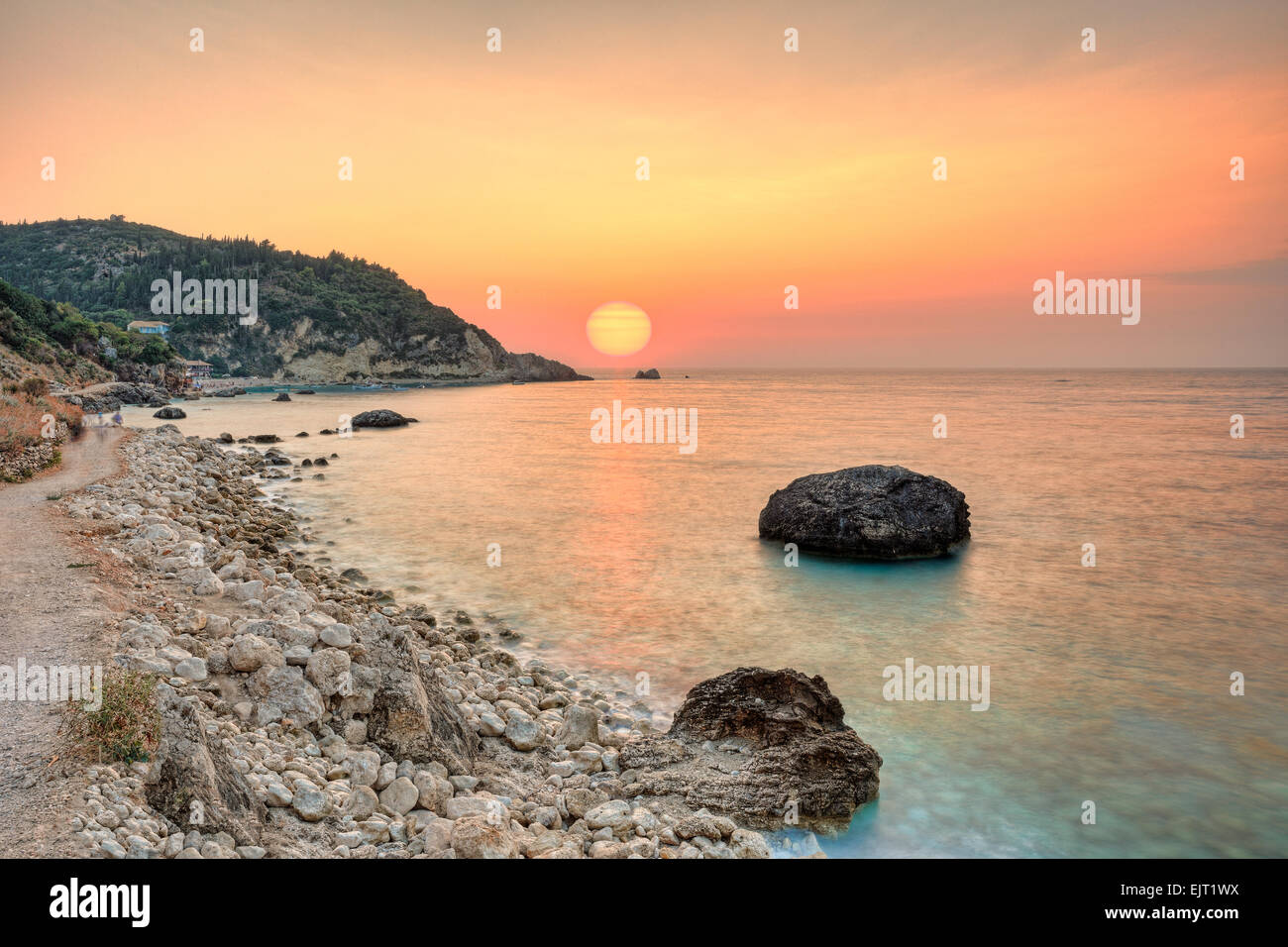 The sunset at the famous village Agios Nikitas in Lefkada, Greece - Stock Image