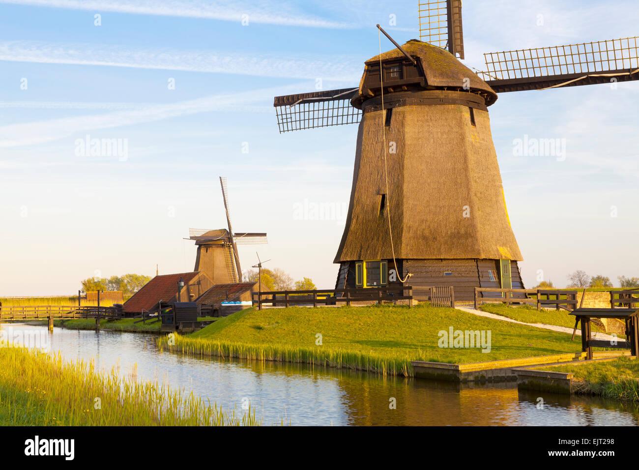 Traditional Windmills beside a Canal, Schermerhorn, North Holland, Netherlands - Stock Image