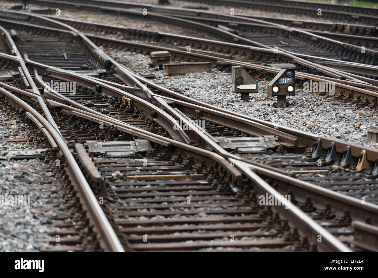 Railway tracks and switches on the track field of Zurich main station, one of Europe's busiest railway stations. - Stock Image