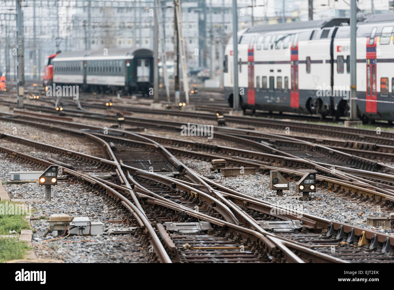 Two trains of Swiss Federal Railways SBB are leaving Zurich's busy main station with its many railway junctions - Stock Image