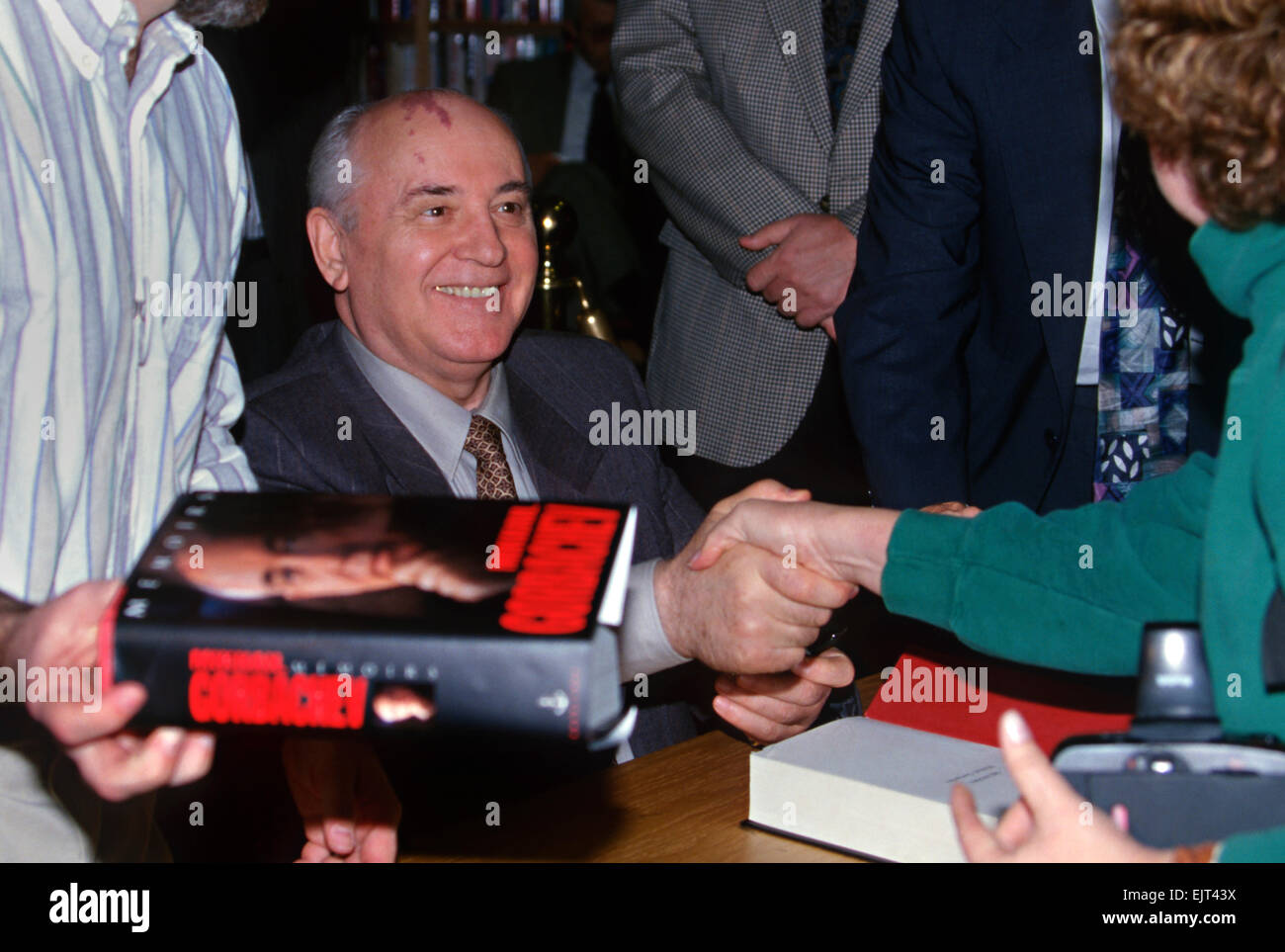 Former Soviet leader Mikhail Gorbachev signs copies of his book at Politics and Prose bookstore October 25, 1996 - Stock Image