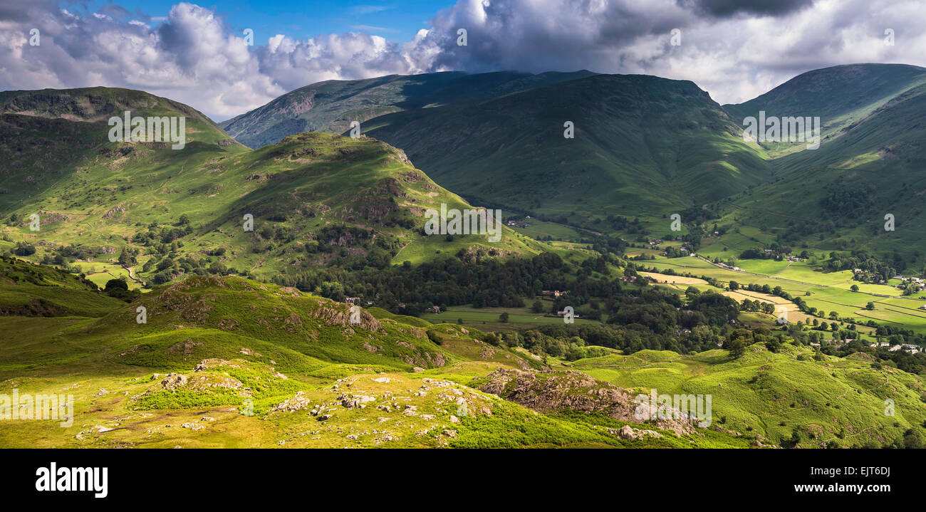 Helm Crag near Grasmere in the Lake District with Seat Sandal and Fairfield in the distance - Stock Image